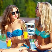 Beautiful Girls Talking On Summer Beach
