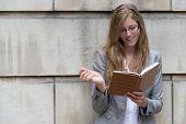 Beautiful, Smiling Woman Writing In Her Journal