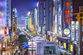 CHENGDU, CHINA - JUNE 2, 2014: Chunxi Street at night. With a history of 85 years, Chunxilu is the m