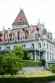 LAUSANNE-OUCHY, SWITZERLAND - JULY 9, 2014: The Hotel Chateau D'Ouchy. Originally an old medieval ca