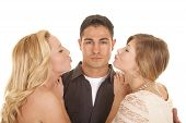 Two Women Ready To Kiss Man Close