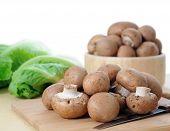 pic of portobello mushroom  - mini Portobello mushrooms on the table with other vegetable  - JPG