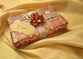 A tag with Eid message in english on a golden decorative gift box