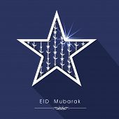 Shiny silver star on blue background for muslim community festival Eid Mubarak celebrations.