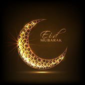 Golden crescent moon on brown background for muslim community festival Eid Mubarak celebrations.