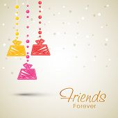 Colorful hanging gift boxes on shiny brown background for Happy Friendship Day celebrations.