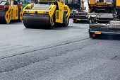 stock photo of vibrator  - Heavy vibration road roller compactors at asphalt pavement works - JPG