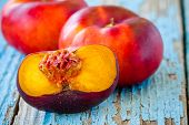 Fresh Organic Flat Nectarines On An Old Wooden Background