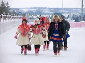 Nadym, Russia - March 3, 2007: Unknown Group Of People Walking Along The Road.