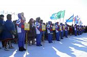 Nadym, Russia - March 15, 2008: Strangers, The Teams Are Standing On The Square With Flags And Plate