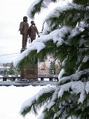Nadym, Russia - November 17, 2002: The Monument To The Builders On The Background Of Winter Nature.