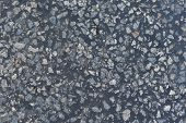 Dark asphalt surface much relief