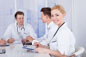 Happy Female Doctor In Conference Meeting