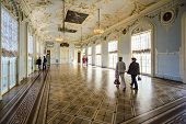 SAINT PETERSBURG, RUSSIA - SEPTEMBER 8, 2013: Visitors tour the Hermitage Museum. Founded in 1764, i