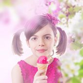 Little cute girl with ice cream and spring blossoms