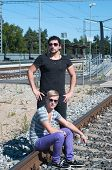 Two attractive young guys on rails