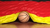 Basketball ball with flag of Germany on parquet floor