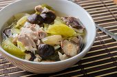 Pickled lettuce soup with shiitake mushroom and pork