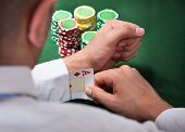Man Pulling Ace Card From Sleeve