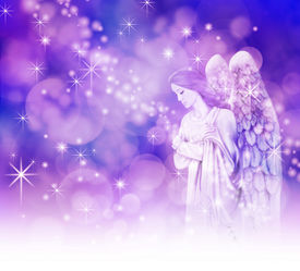 image of christmas angel  - Bokeh and sparkles background with a beautiful Christmas Angel on right hand side in thoughtful pose with arms folded on chest - JPG
