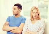 love, family and relationship problems concept - unhappy couple not speaking after having argument at home