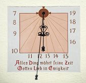 Old German sundial in mural painting
