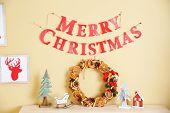 Christmas decorations on wall and shelf