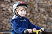 Little Boy Riding Bicycle In Village Or City