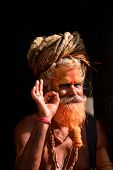 Sadhu Man With Dreadlocks And Painted Face In Pashupatinath