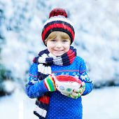 Funny Little Child Holding Big Cup With Snowflakes And Hot Cocoa And Chocolate Drink And Marshmallow