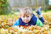 Cute Kid Boy Having Fun In Autumn Park