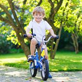Happy Preschool Boy Riding His First Bike