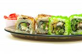 Japanese Cuisine: Rolls With Smoked Eel, Cucumber, Salmon And Avocado On A White Background.