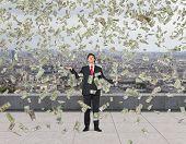 Businessman Catching Flying Money
