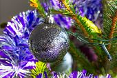 Beautiful purple and silver baubles on Christmas tree