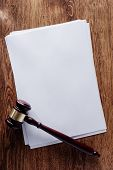Blank Documents And Gavel On Wooden Table