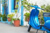 Blue scooter And Greek House On Kalymnos Island