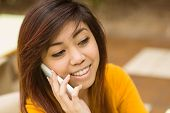 Close up of beautiful young woman using mobile phone