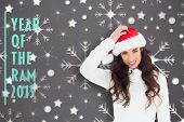Confused brunette in santa hat against snowflake wallpaper pattern