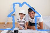 Smiling dad and little boy studying architecture against house outline