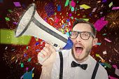 Geeky businessman shouting through megaphone against colourful fireworks exploding on black background