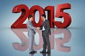 Businessmen shaking hands against purple vignette