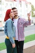 Loving couple near apartment house