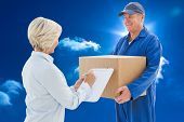 Happy delivery man with customer against bright blue sky with clouds