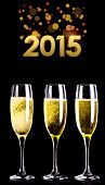 golden 2015 against three full glasses of champagne
