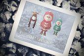 Santa elf and reindeer against tablet pc showing road image
