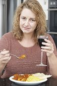 Guilty Woman Eating Takeaway Curry And Drinking Wine