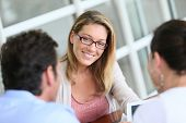 Businesswoman meeting with couple to sign financial contract