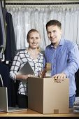 picture of dispatch  - Couple Running Online Clothing Store Packing Goods For Dispatch - JPG