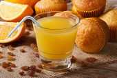 Freshly Baked Muffins With Raisins And Orange Juice, Horizontal